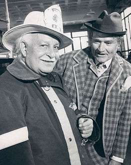 Arthur Fiedler dressed as a firefighter with Red Skelton.
