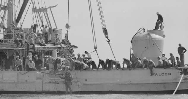 A diver from the Falcon prepares to enter the water to help guide the rescue chamber (right) to the USS Squalus. Courtesy of the Boston Public Library, Leslie Jones Collection.