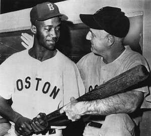 Pumpsie Green, left, with Boston Red Sox, manager Billy Jurges