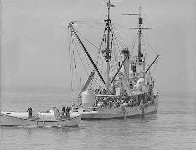 The salvage tug Falcon on the way to rescue the crew of the Squalus. Photo courtesy Boston Public Library, Leslie Jones collection.