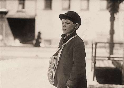 "Hartford newsboy Tony Casale, 11, in 1909. He had been selling newspapers for four yers, and sometimes until 10 p.m. His boss said his father bit him on the arm for not selling more papers. Said Tony, ""Drunken men say bad words to us."""