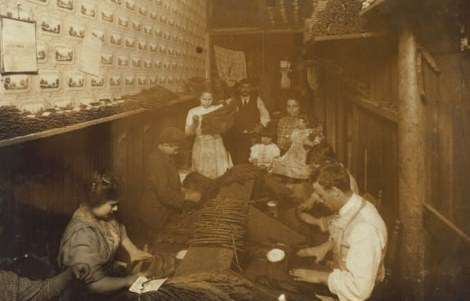 "Cigar factory at 205 Atwells Ave. in Providence, R.I. Hine wrote, 205 Atwells Av., Providence, R.I. ""Eight year old boy and ten year old girl are stripping. This room is the living, -sleeping-and-working room and adjoins the store. Nov 23, 1912. Very dirty and ill-kept."""