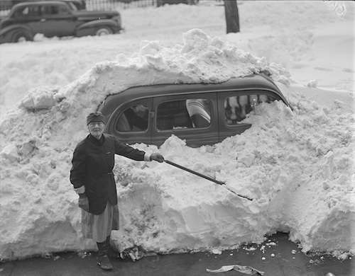 A woman digs out after the blizzard. Photo courtesy Boston Public Library, Leslie Jones Collection.