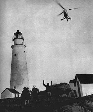 Lighthouse keeper family waves to Flying Santa, 1946