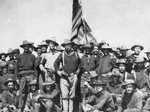 Teddy Roosevelt with his Rough Riders. Roosevelt carried a Colt revolver.