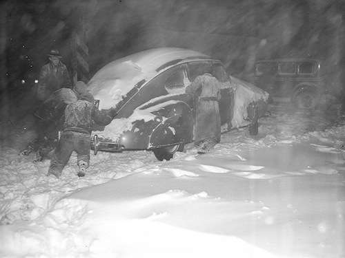 An auto stuck in the snow.