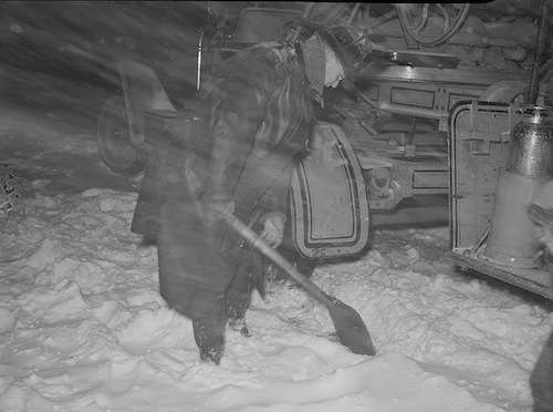 A firefighter tries to shovel out his truck during the storm.