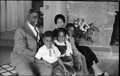 Jackie Robinson at home in Stamford with his wife Rachel, sons David, Jackie Jr.. and Sharon.