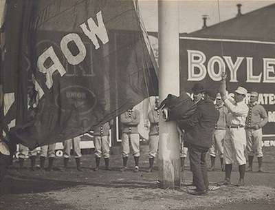 Boston Americans player-manager Jimmy Collins raises the World Championship flag before the 1904 home opener. Photo courtesy Boston Public Library, Michael McGreevey collection.