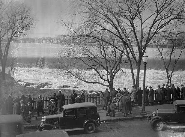 People watching the Merrimack River in Lawrence, Mass. Photo courtesy Boston Public Library, Leslie Jones Collection.