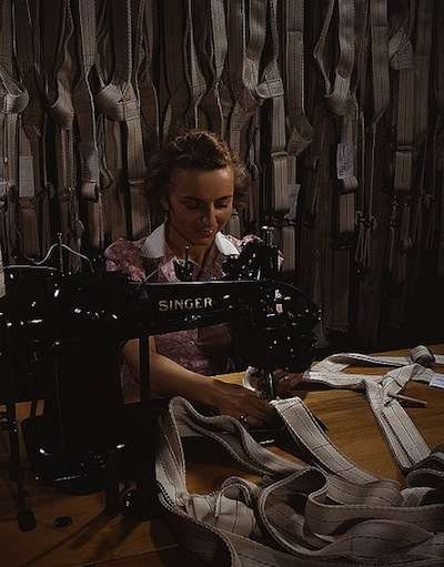 Mary Saverick sews a parachute harness