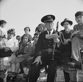 Gloucester, Massachusetts. Memorial Day, 1943. An aged member of the American Legion band resting after the parade.
