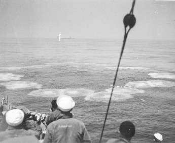 Sailors aboard USS Moberly firing on U-853.