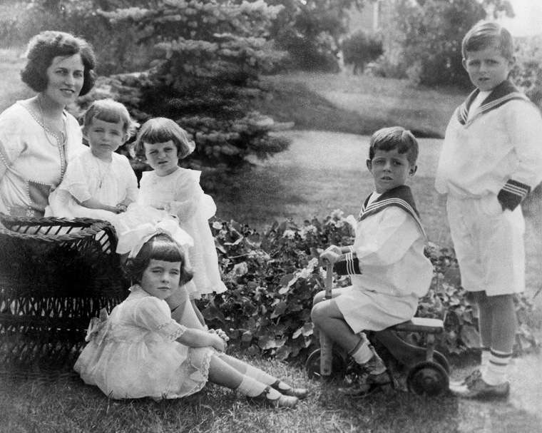 Rose Kennedy and her children, circa 1922. L-R: Rose Kennedy, Eunice Kennedy, Kathleen Kennedy, Rosemary Kennedy (seated in foreground), John F. Kennedy, and Joseph P. Kennedy Jr. Bachrach Studios photograph in the John F. Kennedy Presidential Library and Museum, Boston.