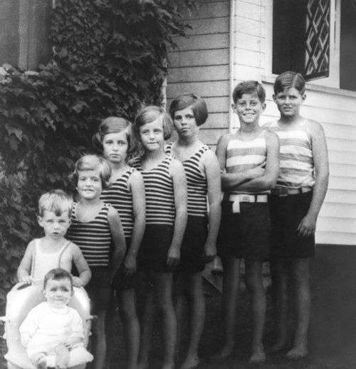 The Kennedy Children, 1928 (L-R) Jean, Bobby, Patricia, Eunice, Kathleen, Rosemary, Jack, Joe Jr. Hyannisport, 1928. Photograph in the John F. Kennedy Presidential Library and Museum, Boston.