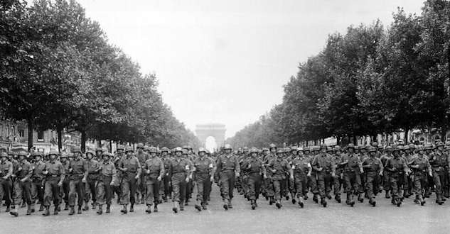 Norman Cota. D-Day hero, led U.S. Army troops in the parade down the Champs Elysees celebrating the liberation of Paris.