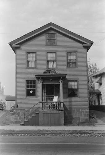 'House with articles on roof of porch during fall house cleaning, Meriden, Conn.' Photo courtesy Library of Congress.