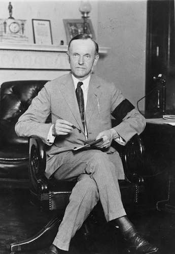 Calvin Coolidge, wearing a black armband for President Hardin