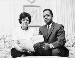 Betty and Barney Hill holding the 1966 book Interrupted Journey.