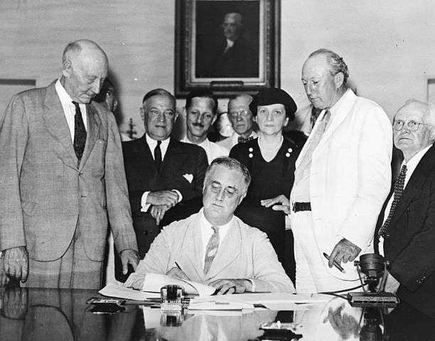 President Roosevelt signs the Social Security Act.