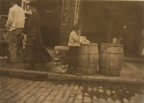 A Boston boy finds his dinner. Photo by Lewis Hine, courtesy Library of Congress.