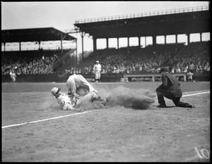 Unknown Detroit Tigers player slides into third base against unknown Boston Red Sox third baseman as ball pops loose in front of unknown umpire during a 1929 game at Fenway Park. The Red Sox probably lost. Photo courtesy Boston Public Library, Leslie Jones Collection.