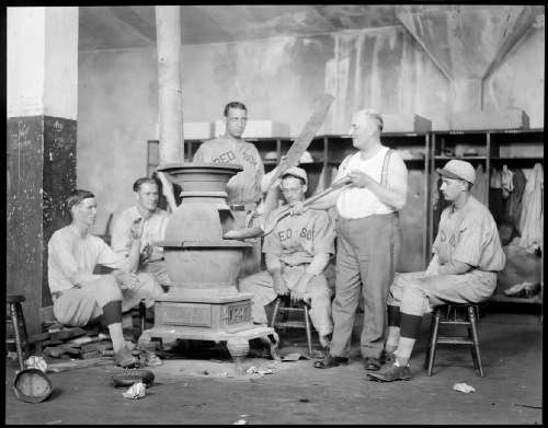 Boston Red Sox trainer Bits Bierhalter stokes up the hot stove in clubhouse at Fenway, 1928 or 1929. Photo courtesy Boston Public Library, Leslie Jones Collection.