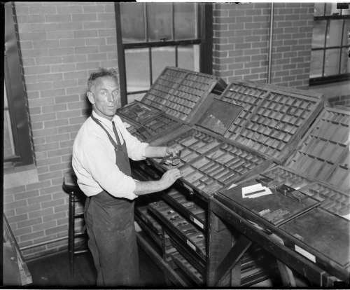 Clarence DeMar in his print shop. Photo courtesy Boston Public Library, Leslie Jones Collection.