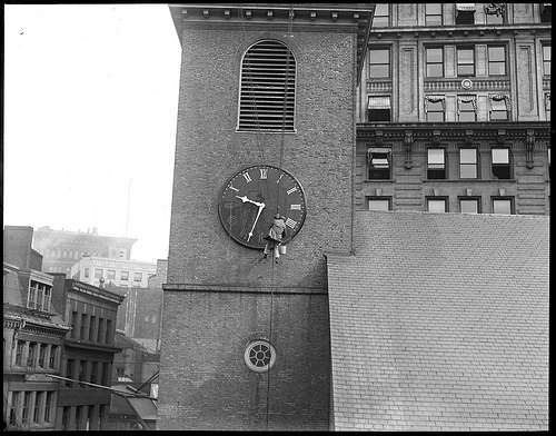 Old South clock being painted, early 20th century. Photo courtesy Boston Public Library, Leslie Jones Collection.