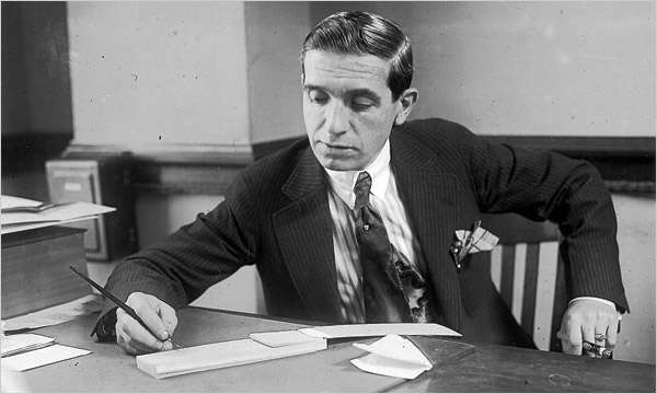 Charles Ponzi in his office. Photo courtesy Boston Public Library, Leslie Jones Collection.