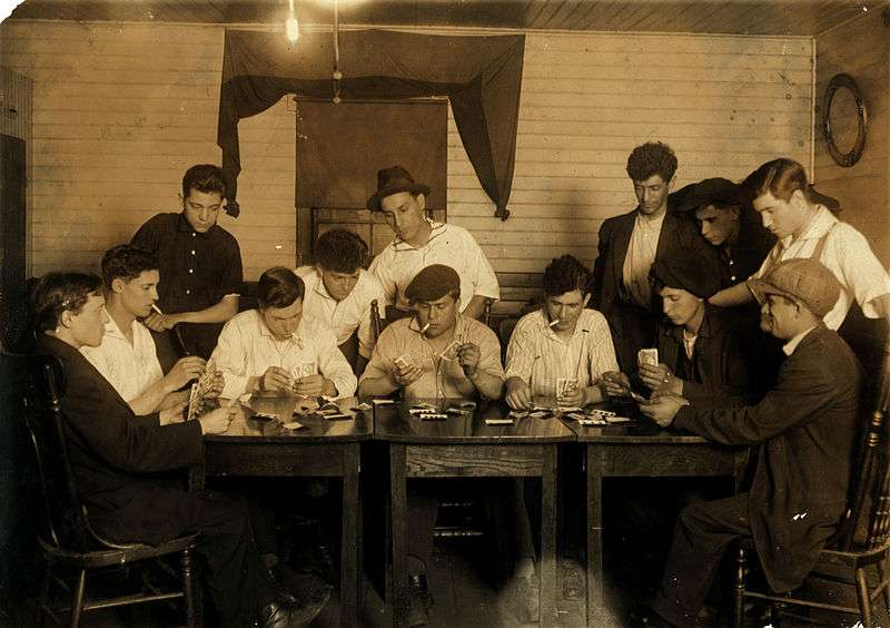 "Evening recreation of the ""Young Holy Ghosters"" – Ages 15–25, average is 18 – all mill workers – all Portuguese. Whole House on George Street. Great need of leadership. Location: Fall River, Massachusetts. Photograph by Lewis Wickes Hine, 21 June 1916. Photo courtesy Library of Congress."