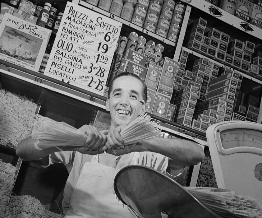 Charles Ruggiero, clerk in a grocery store in New York's Italian section, wishes the handful of spaghetti he is breaking were Mussolini's neck. Photo courtesy Library of Congress.