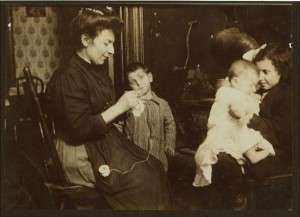An Italian immigrant family, 1911. Photo by Lewis Wickes Hine, courtesy Library of Congress.