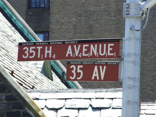 Street sign in Jackson Heights