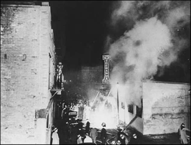 Smoke rises from the Cocoanut Grove. Photo courtesy Boston Public Library.
