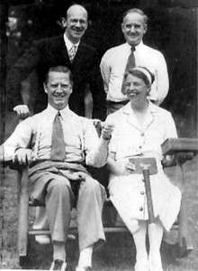 Eleanor Roosevelt seated next to her outspoken critic Westbrook Pegler. Behind her is George Bye and beside him is critic Deems Taylor.