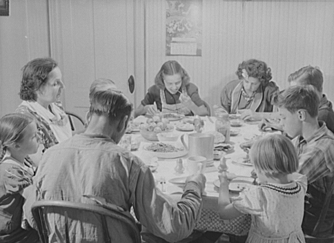 Not quite a reveillon: Franco-American potato farmer and his family eat dinner in Wallagrass, Maine. Photo courtesy Library of Congress.