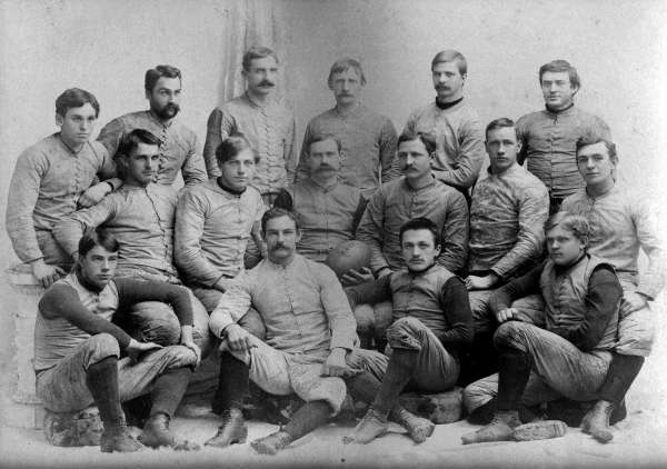 1892 Springfield College Football Team. Naismith and Morgan are in the middle row, Naismith in the center holding the football and Morgan second from the right. Courtesy of Springfield College, Babson Library, Archives and Special Collections.