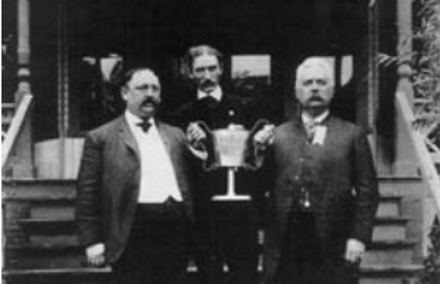 Jerome Hale, right, in front of his tavern