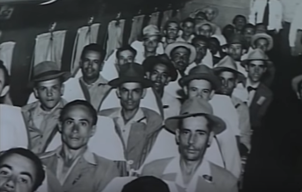 Puerto Rican men immigrating to the United States. Photo from the film 'Puerto Rican Passages.''