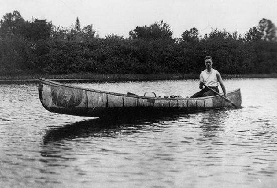 Young Franklin Roosevelt in the canoe made by Tomah Joseph