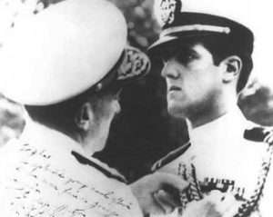 Young John Kerry receives a medal