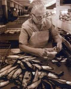 A sardine factory worker, identity unknown.