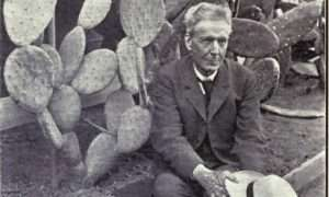 Luther Burbank poses with a variety of spineless cactus.