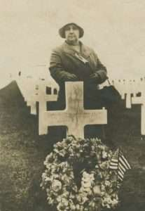 Alice Swan at the Meuse-Argonne American Cemetery in France, next to a marker for 'An American Soldier' that might have been her son.