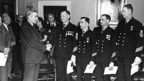 Medal of Honor recipients, honored for their courage in rescuing the Squalus survivors.