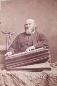 Alfred Little seated with his melodeon